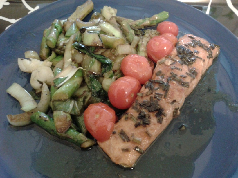 Grilled salmon with pomegranate molasses, served with roast tomatoes and sautéed asparagus and pak choi.